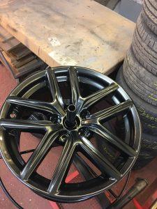 Powder coated diamond cut alloy wheel